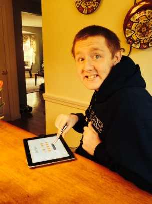 Daniel, a 17 year old with autism, using Let's be Social!