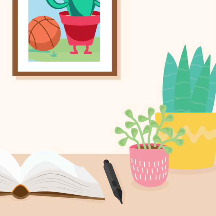 Desk with open notebook, pen, and two potted plants. A picture of someone with a basketball is hanging on the wall.