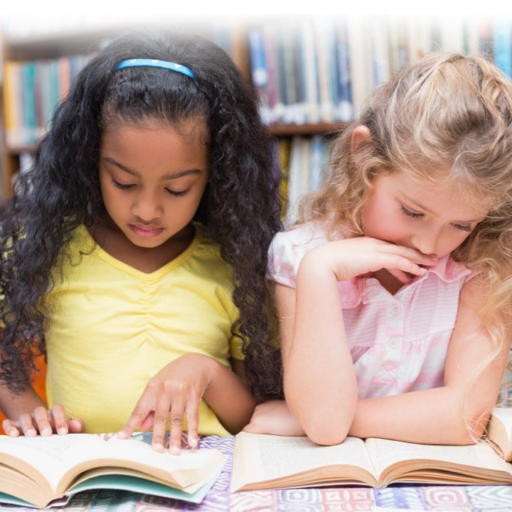 Phonological awareness and dyslexia - two young girls reading together