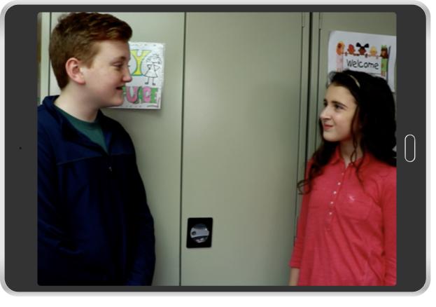 boy talking to girl by lockers