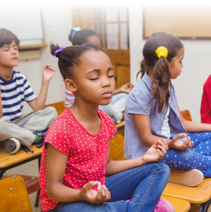 children meditating on their desks